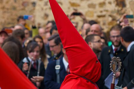 Man with red hood. Nazarene from Semana Santa catholic parade in Caceres, Spain