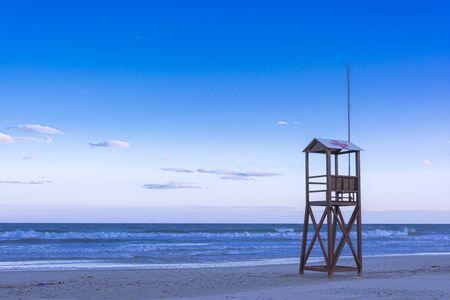 Classic Blue beach sunrise with lifeguard wooden tower Banco de Imagens