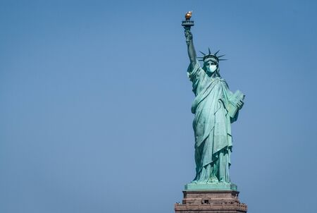Statue of liberty wearing a surgical mask