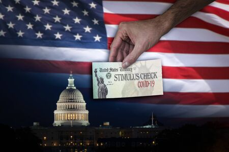 Man handing Stimulus check to people with the US Capitol and flag on the Background.