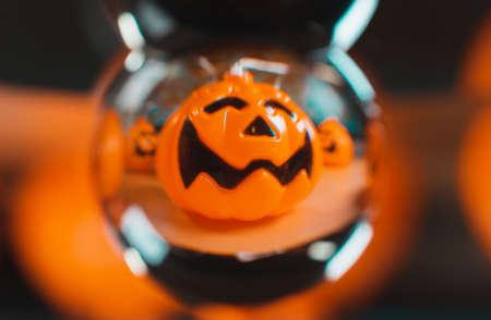 Halloween orange pumpkin seen through a crystal ball