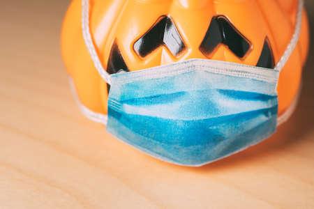 Orange pumpkin wearing a protective medical mask. Reklamní fotografie