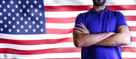 Torso of a man Young man with arms crossed against united states national flag