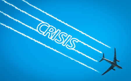 Airplane leaving jet contrails with Crisis word inside