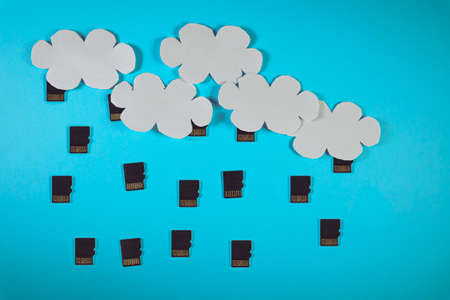 Cloud computing concept, paper clouds with micro SD cards as raindrops 스톡 콘텐츠