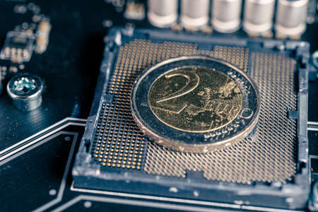 2 euro coin over a CPU slot in a motherboard, symbolizing the Digital Euro.