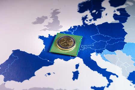 2 euro coin over a CPU on an EU map, symbolizing the Digital Euro.