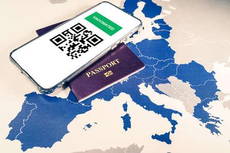 Digital green passport with QR code on a smartphone over an EU map 版權商用圖片