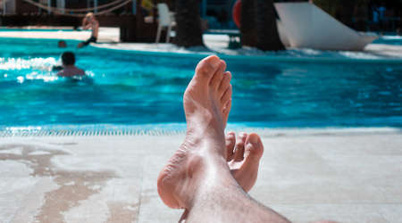 Caucasian man resting and relaxing in the pool once you can go back to travel and enjoy the vacation.