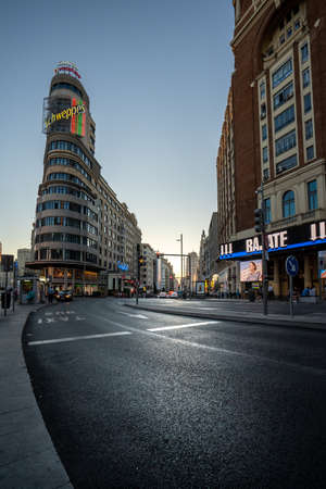 Madrid, Spain - June 2019: Gran via Avenue at the iconic schweppes building.