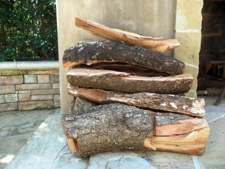 Logs on a backyard fireplace