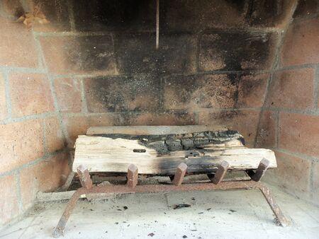 A blackened backyard fireplace 版權商用圖片