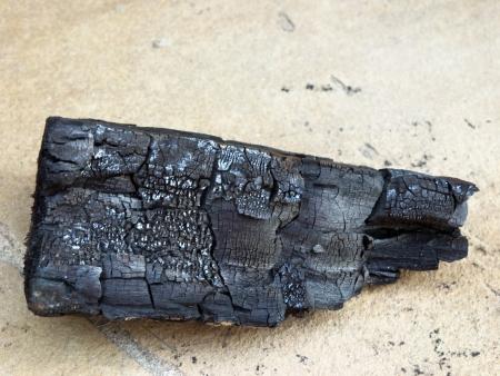 A burned piece of fire wood Banco de Imagens