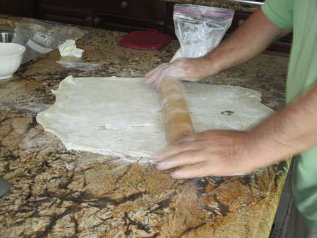 A man rolling dough Stok Fotoğraf