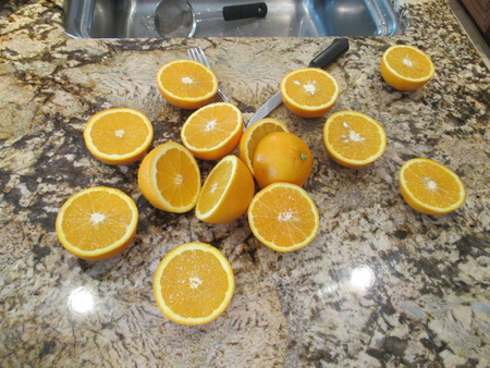 Sliced oranges on a granite counter Stock fotó