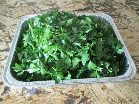 Cut parsley in an aluminum pan