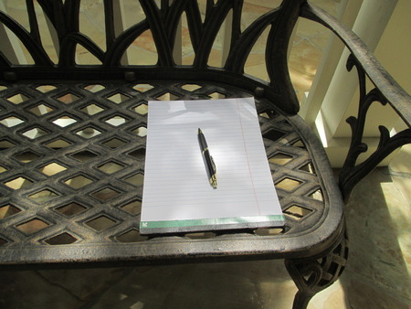 writing pad: A writing pad on a bench