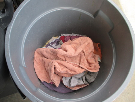 Rags in a gray garbage can