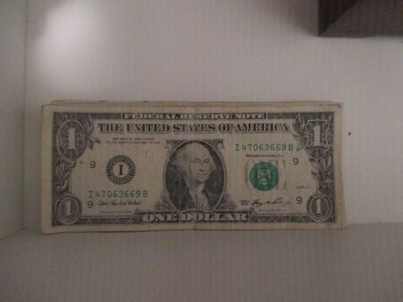drawer: Dollar bills in a white drawer