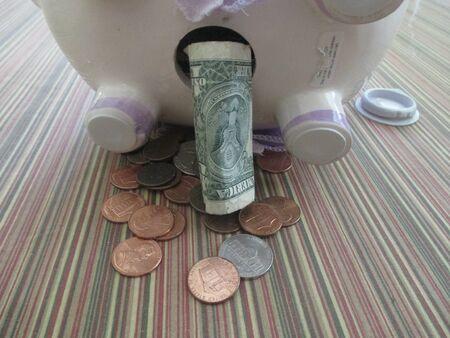 money from a white piggy bank Banco de Imagens