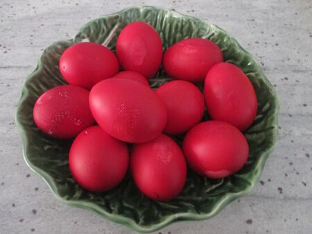 Red Orthodox Easter eggs in a green bowl