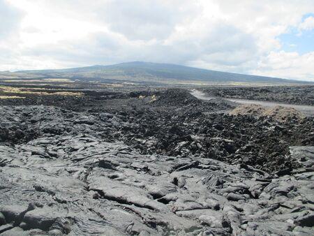 Road going into a Hawaiian lava field