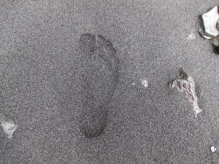 Footprint on a black sand beach in Hawaii Stock fotó - 63073230