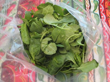 Spinach leaves in a small plastic bag
