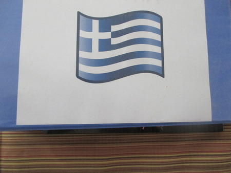 Small Greek flag on a blue and white binder Stockfoto