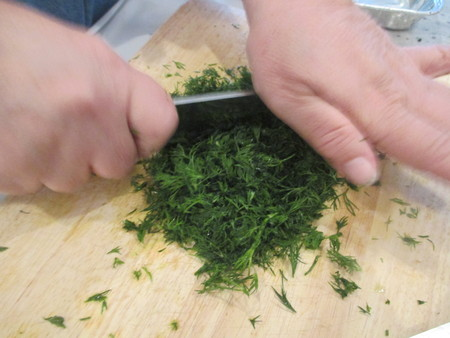 woman chopping dill Stockfoto