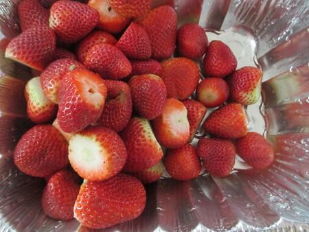Strawberries in a deep aluminum pan