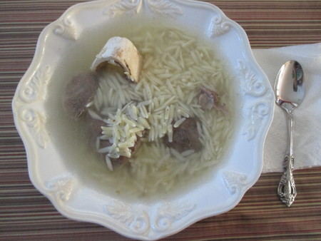 A bowl of beef and orzo soup