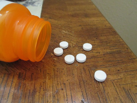 six white pills on a night table