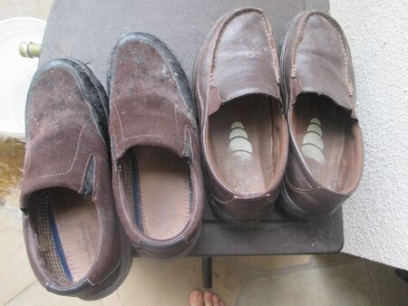 Two pairs of men's brown shoes