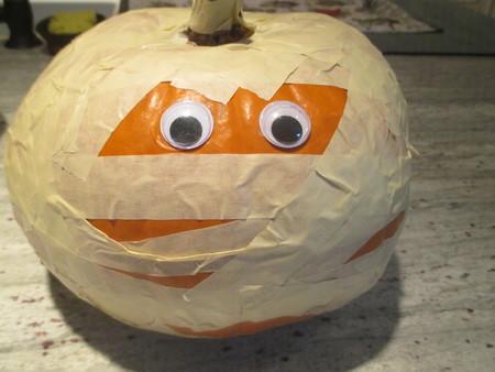 Halloween pumpkin decorated as a mummy