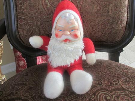 Vintage Santa Claus doll in a browm chair