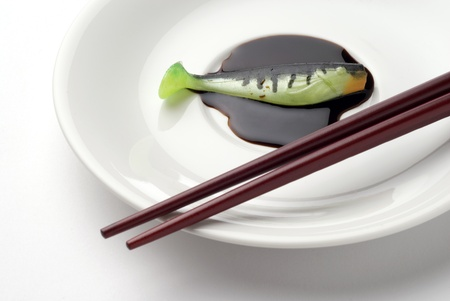 Chopsticks with artificial fishing bait photo