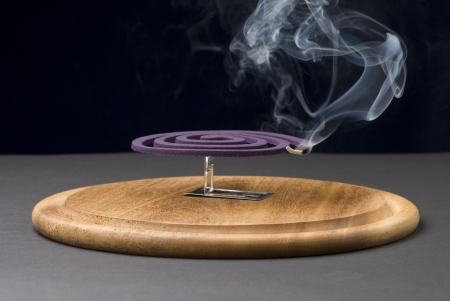 mozzie: Mosquito coil with smoke, Text Space, Mosquito repellent. Stock Photo