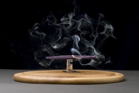 insectiside: Mosquito coil with smoke, Text Space, Mosquito repellent. Stock Photo