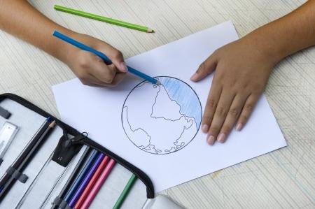 Little boy drawing earth, Earth saving. photo