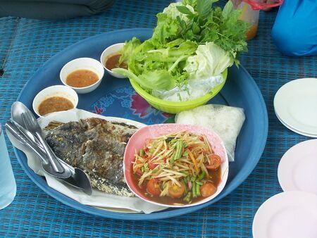 somtum: Somtum and fish burn thai food Stock Photo