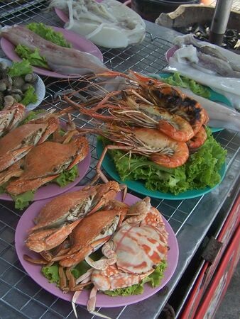 total up the seafood cooks fresh , beach rim bangsan, pattaya,jomtain,cholburee , the tourist attraction is popular of Thailand tall , photo