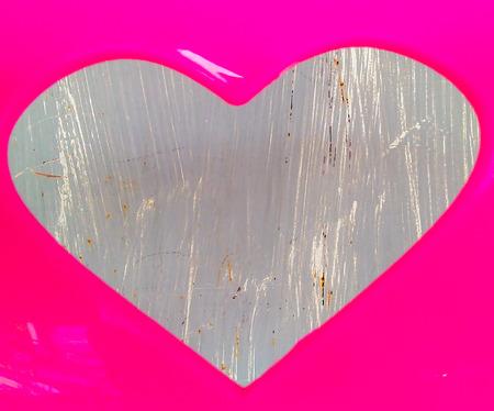 universal love: Coraz�n rosado. D�gale a la brillante y feliz y un s�mbolo universal del amor. Foto de archivo