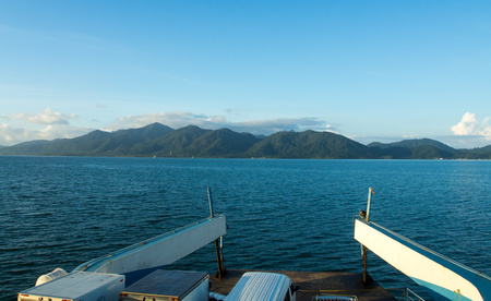 trat: Boat crossing from Koh Chang, along with passengers and vehicles. Stock Photo