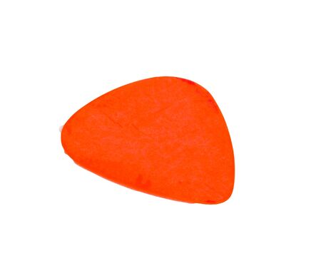 Isolated on white background orange guitar pick with clipping path