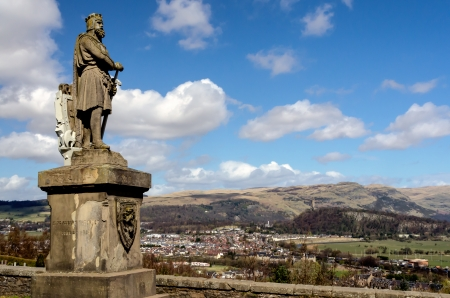 Robert the Bruce statue with Stirling and Wallace Monument in the background, Scotland