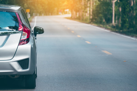 Close up of new silver hatchback car parking on local road with Stock Photo