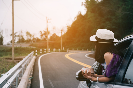 Asain woman traveler with hatchback car with beautiful mountain Stok Fotoğraf
