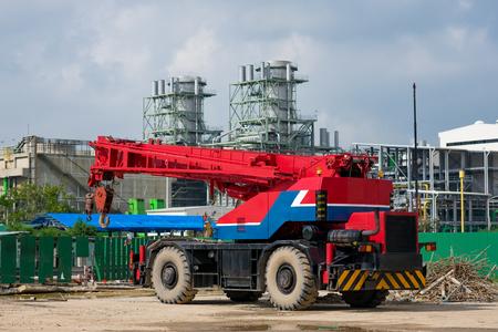 Mobile crane against powerplant construction background