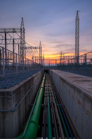 High voltage electricity pylon over Twilight in power plant